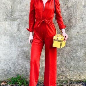 Bright orange 1970's bell bottom jumpsuit